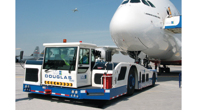Jumbo Tractor Tow : Douglas aircraft towing tractors aviationpros