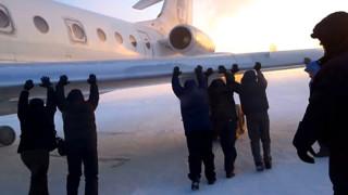 Russian Passengers Push Plane Stuck In Ice In Siberia