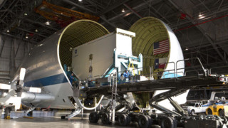 Super  Guppy Flies In  Plane Part For Testing