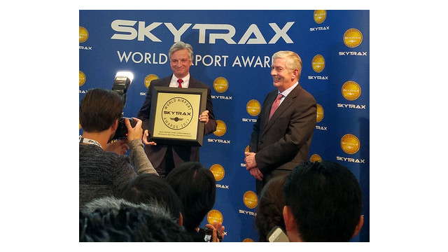 Dan Boivin chair of the Metropolitan Airports Commission with the plaque