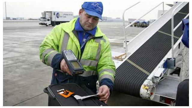 Airport Baggage Handling Scan : Forgotten scanner gets sucked into departing jet