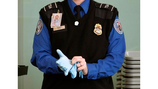 TSA-Agent-Putting-On-Search-Glove.jpg