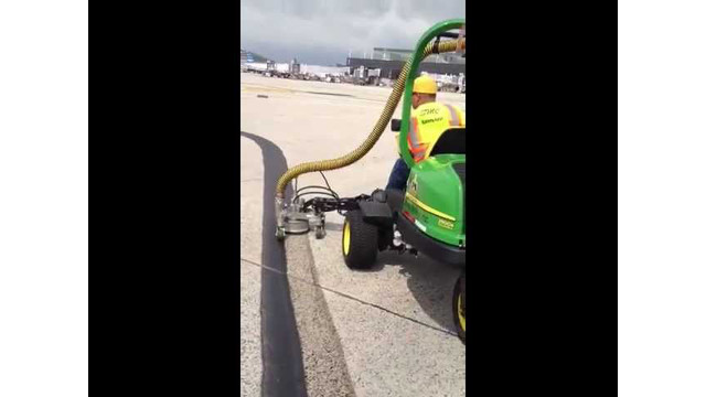 SH8000 with Hog Rider tractor doing paint removal on taxiway