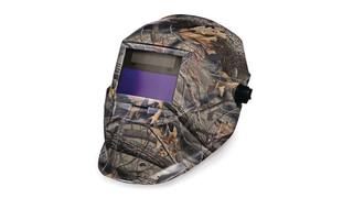 Camouflage auto-darkening helmet