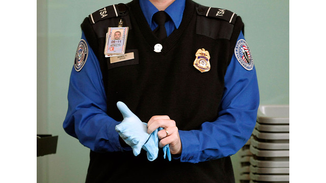 TSA-Agent-Putting-On-Search-Glove.jpg